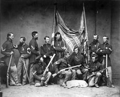 American Civil War: Color guard of the 7th Illinois Infantry armed with Henry repeating rifles, c. 1863. The photo is carefully posed. The photographer has given specific instructions to each person as to the direction of his gaze. The Henry and lever action were game changes in warfare still dominated by the musket