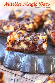 Nutella Magic Bars from Roxanashomebaking.com Oozing Nutella, melted chocolate, crunchy hazelnuts and a buttery crust in one irresistible bar