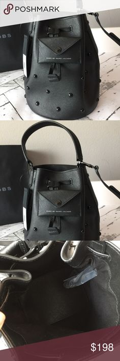 Marc Jacobs Bucket Bag NWT Brand new with tags authentic Marc by Marc Jacobs Bucket Bag. This is a large brushed black leather satchel bag with handle. Crossbody detachable strap included. Top drawstring closure. Small pocket on the outside is super cute detail. Marc by Marc Jacobs Bags Satchels