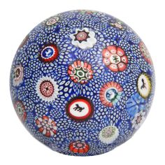 A Rare Antique Baccarat Carpet Ground Paperweight  France  1848  A rare antique Baccarat cobalt blue and white carpet ground paperweight with Gridel silhouette canes, signed B1848