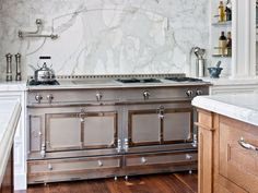 Elegant features include a Christopher Peacock-designed kitchen adorned in marble.