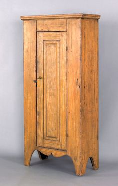 Pennsylvania painted pine chimney cupboard, 19th c., retaining an old ochre grained surface, 57.5 H. x 25.5 W.