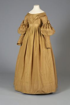 Gold silk taffeta dress, probably American, 1830s, KSUM 1983.1.50.