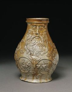 """1540, Köln. H: 20cm. W: 14.5cm (incl handle, shown on V&A page). Iron wash, salt glaze. Bartmann jug found in Mary Rose wreckage. Probably used as a drinking vessel. Exported all over northern Europe, heavy-duty stoneware was used """"at almost any social level."""" –V&A"""