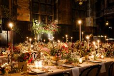 """Kelsey Falter and Steve Martocci - """"Banquet style table setting in the refectory at The High Line Hotel, florals by Saipua; large floral arrangements with vines from the windows. We featured an assortment of dahlia varieties, which were in season the month that we were married."""""""