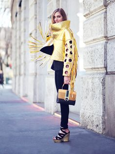 Chiara Ferragni of The Blonde Salad rocking a gold jacket with perforated sleeves