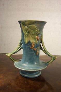 Roseville Pottery Blue Bushberry Vase click the image or link for more info. Weller Pottery, Antique Pottery, Roseville Pottery, Mccoy Pottery, Pottery Vase, Ceramic Pottery, Ceramic Art, Thrown Pottery, Ceramic Decor