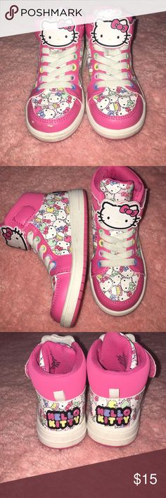 Hello Kitty high tops for girls. Girls Hello Kitty girls high tops in size 9 1/2. Has some scuffing in front of shoe as shown in picture. Shoes Sneakers