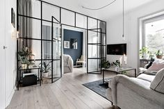 Small Scandinavian apartment with glass wall