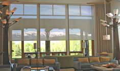 Very large windows can make a room uncomfortably hot or bright. Insolroll® solar shades keep this room comfortable, and motorized operation makes lifting these large, high shades a breeze. Large Window Treatments, Window Coverings, Residential Skylights, Automatic Shades, Window Roller Shades, Roller Blinds, Skylight Shade, Motorized Shades, Solar Screens
