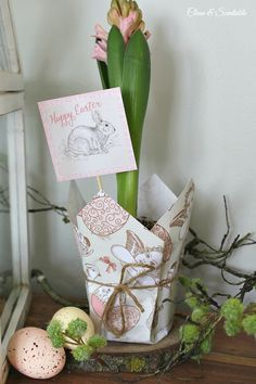 This cute Easter planter would make a cute hostess gift or could be used in a variety of ways in your Easter decor. Free printable Easter paper and Easter tags included.