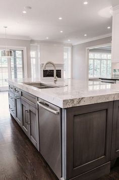 interior of kitchen white kitchen cabinetry with grey accent island chrome 12715