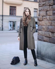Black classy and casual outfit with wool coat in olive