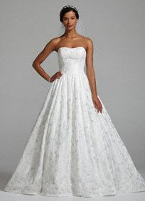 Beyond breathtaking, this truly magnificent ball gown will make your wedding day even more magical!   Strapless taffeta gown with an ultra-feminine sweetheart neckline is simply enchanting.  All over eye-catching intricate beaded detail adds tons of sparkling.  Full ball gown skirt creates a dramatic and unforgettable look.  Chapel train. Available in Soft White.  Fully lined. Back zip. Imported polyester. Dry clean.