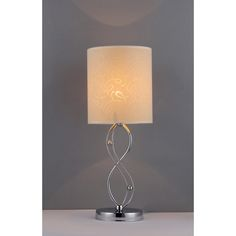 Light up your living room and provide a great accent piece with this crystal table lamp. The simple yet elegant base is topped with a paper shade that lets just the right amount of light through. This lamp requires a single 60-watt bulb.