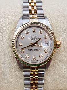 Sought after pre-owned classic Rolex Ladies Datejust 79173 bi-colour with a diamond dial from year 2000. With Box, papers and 1 year warranty.