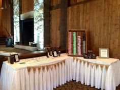 This corner display for both guestbook and wedding favors is one-stop shopping for your guests at the Heritage Resort and Conference Center, Southbury, CT