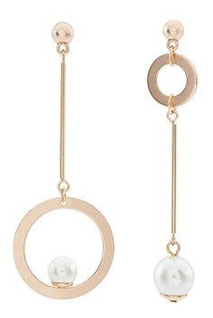 This season is all about rocking a statement earring, and our mismatched circle pair will up your style status in seconds. In gold-tone metal, they feature g. Tiny Stud Earrings, Emerald Earrings, Emerald Jewelry, Cartilage Earrings, Pearl Jewelry, Gemstone Jewelry, Jewelery, Hoop Earrings, Earring Trends