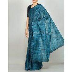 'Teal blue color pure handloom Tussar silk  saree with matching blouse.This silk sari has got blue floral natural jaipuri block prints over the body and the elegant pallu.And it has jaipuri block printed self color border on either side.It is suitable for party and traditional wear'