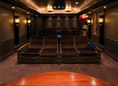 Jerry Rice, one of the greatest wide receiver's to ever play in the NFL, has this amazing movie theater in his home. Being a huge movie buff, I would more than enjoy having a theater like this in my home.