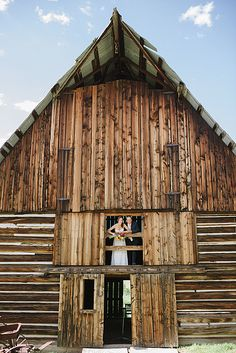 Rustic, Rocky Mountain weddings are our bread and butter.  Don't you just love this cute couple peaking out of the traditional barn?? Heritage Barn, Lake Catamount.