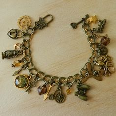 An exquisite charm bracelet inspired by all things steampunk Embellished with 21 stunning antique gold and bronze toned charms. The bracelet goes. Charm Bracelets, Steampunk, Bronze, Charmed, Inspired, Gold, Inspiration, Image, Jewelry