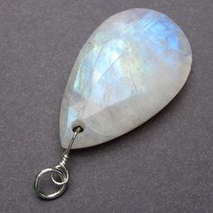 One of A Kind Faceted Rainbow Moonstone Sterling Silver Wire Wrapped Dangle Pendant Charm with Sterling Silver Jump Ring. $28.95, via Etsy.