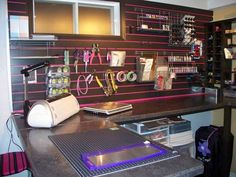I wanna paint my slat wall like this. Maybe not black and pink, but some color combination.