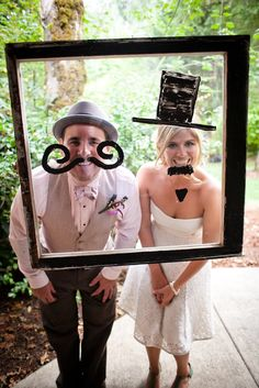 Hang a picture frame with glass in it and give your guests dry erase markers for a fun photo! (Ok the frame idea is cute but not why I'm pinning this- ISN'T THE BRIDE AND GROOM OUTFITS ADORABLE!!!??? You should get similar styles! You both would rock them! - for mor gerat ideas and inspiration visit us at Bride's Book