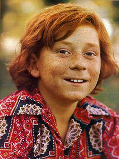 CHERYL: Redhead with sitcom