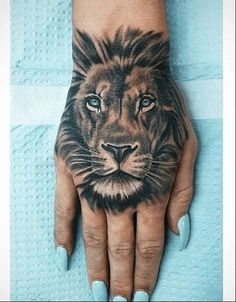 Lion tattoos hold different meanings. - Lion tattoos hold different meanings. Lions are known to be proud and courageous creatures. Tiger Hand Tattoo, Lion Head Tattoos, Leo Tattoos, Body Art Tattoos, Tribal Lion Tattoo, Tatoos, Tattoos Of Lions, Tattoos On Hand, Lion Back Tattoo
