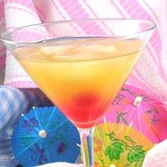 """Pineapple Upside-Down Cake in a Glass """"Cake-flavored vodka just may be the best thing in a bottle; it tastes great mixed with just about anything. This yummy cocktail combines the flavored vodka with pineapple juice for a sweet treat. Fresh pineapple also makes a great garnish."""""""