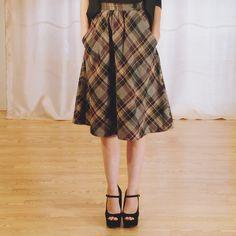 Vintage A-Line Plaid Skirt. $20.00, via Etsy. Just like Amber's wearing!