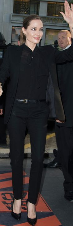 Who made  Angelina Jolie's black pants suit, mesh bow, top, and black pumps that she wore in Paris on June 3, 2013?
