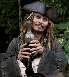 °~ Captain Jack Sparrow and another bottle of rum