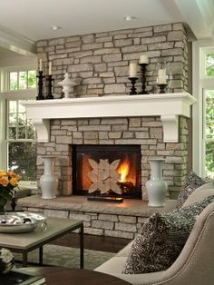 The beautiful stone on the fireplace is Fond du lac Cambrian Blend The corbels are available to purchase from Casa Verde Design The paint color is a Farrow and Ball paint color - Stoney Ground #livingdesign