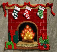 Bucilla ~ Fireside Glow ~ Felt Christmas Wall Hanging Kit Now you will be able to enjoy that experience even if you don't have a fireplace of your own. Bucilla felt applique kits are a Christmas tradition. Felt Christmas, Christmas Stockings, Christmas Crafts, Christmas Ornaments, Xmas, Christmas Wall Hangings, Christmas Door Decorations, Holiday Decor, Christmas Classroom Door