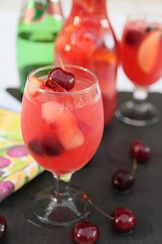 White Peach and Cherry Sangria 6-8 Servings 1 bottle white wine  2 oz triple sec  1/2 C frozen margarita mix (I used a Bacardi mix)  Juice from 1 large lemon  Peach and orange puree (puree 3 peaches and 1/2 an orange, peeled)  2-4 oz simple syrup (equal parts sugar and water boil  2 minutes in saucepan) and cool  3 peaches, peeled, pitted and sliced  1/2 lg orange; cut in segments  2 apples, cored and sliced  25 cherries, pitted  Cherries and/or mint for garnish