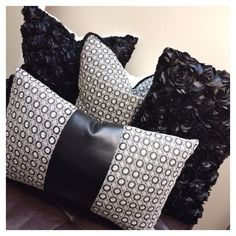 This collection is Pretty & Plush all wrapped into one!   Plush Ebony Rosé:  Textured black satin rose petals reverse to a solid black, envelope style backing/closure.   Ebony & Ivory Luxe Leatherette & Embroidery: Cream discs embroidered onto a sheer black fabric with a faux leather strip ...