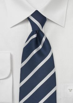 We recently Pinned a great men's outfit from an article in Buzzfeed and have been scouring the interwebs looking to recreate it! Here's the original Pin http://www.pinterest.com/pin/508836457870484278/ And here's a similar tie:  Elgant Navy and Silver Stripe Tie