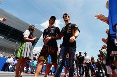 Daniel Ricciardo Red Bull Racing and Romain Grosjean Lotus F1 Team Austrian GP 2014