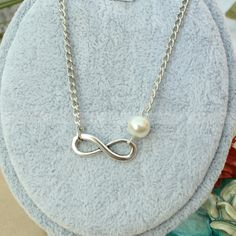 Infinity necklace- bridesmaid gift - pearl infinity necklace, gift for BFF, wife and girlfriend. $6.99, via Etsy.
