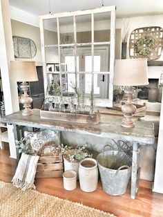Farmhouse entryway table with hanging window for a room divider. IG @bless_this_nest
