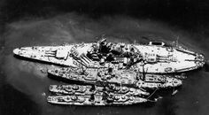 USS South Dakota and two destroyers alongside USS Prometheus for repairs…