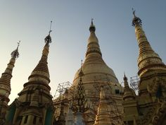 Golden temples in Myanmar at dawn. Myanmar's reforms are allowing amazing temples like this to be restored.