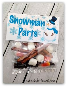Snowman Parts! Mini marshmallows, chocolate chips, pretzel sticks, candy corn. Too cute!!!