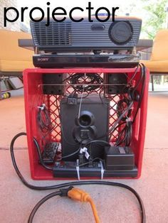 Backyard theater projector setup Tutorial via Instructables - I like how this exemplifies how compact you can be with your setup. A laptop for video, the projector, and it looks like speakers in the bottom. complete with power strip!