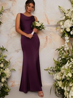 """SATIN SLIP MAXI DRESS Cowl neckline. Cami straps. Cowl back. Concealed zip fastening. Tight cut to body. Evening maxi length. Model wears a size 8/ EU 36/ US 4 and is 5'9.5"""" tall Product code: 1214ABER Material: 100% Polyester A satin slip dress will never go out of style, the Tanne dress is a timeless classic; a draped cowl neckline and back to create maximum elegance and the rich satin in a luxe berry hue is perfect to give your bridesmaids a look they will adore! Ideal for: Bridesmaid duties Bridesmaid Duties, Wedding Dresses, Bridesmaid Ideas, Chi Chi, Tight Dresses, Girls Dresses, Satin Slip, Street Style Women"""