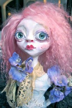 I made the eyes on this dollie and dyed the hair. Still fussing to get my own style of course..but I love her anyway. I carry her around and kiss her like a little girl and her dollies..smile  Learned technique from Sheri DeBow
