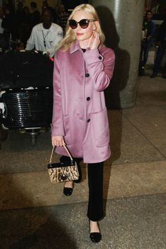 Who: Kate Bosworth What: A Pink Statement Coat Why: The actress takes wintry style to bright places in a rosy pink, mid length boxy coat. Get the look now: Les Copains coat, $778, lescopains.com.